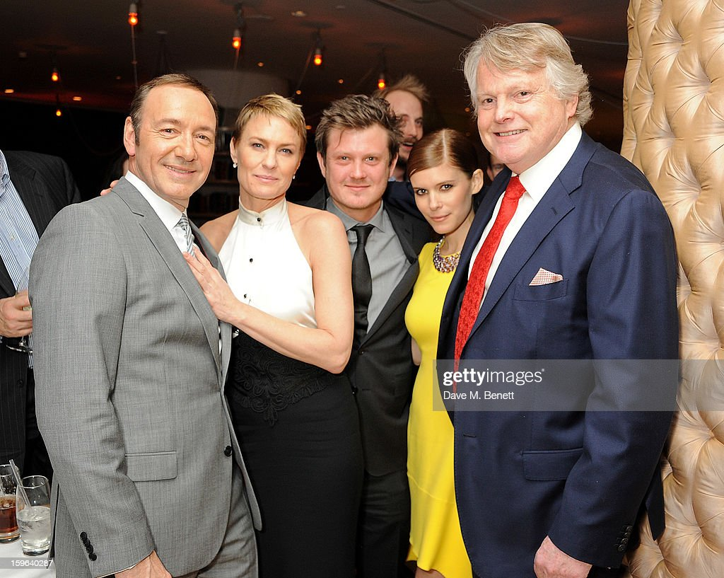(L to R) Kevin Spacey, Robin Wright, Beau Willimon, Kate Mara and Lord Michael Dobbs attend an after party celebrating the Red Carpet Premiere of the Netflix original series 'House of Cards' at Asia de Cuba, St Martins Lane Hotel, on January 17, 2013 in London, England.