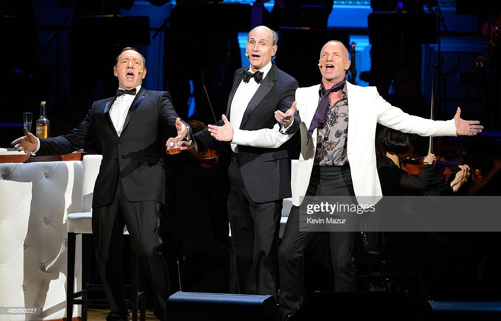Kevin Spacey, Sting and James Taylor perform onstage during The 2014 Revlon Concert For The Rainforest Fund at Carnegie Hall on April 17, 2014 in New York City.