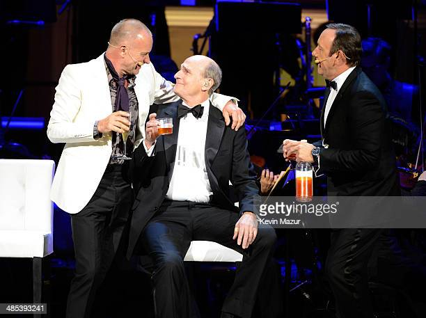 Kevin Spacey Sting and James Taylor perform onstage during The 2014 Revlon Concert For The Rainforest Fund at Carnegie Hall on April 17 2014 in New...