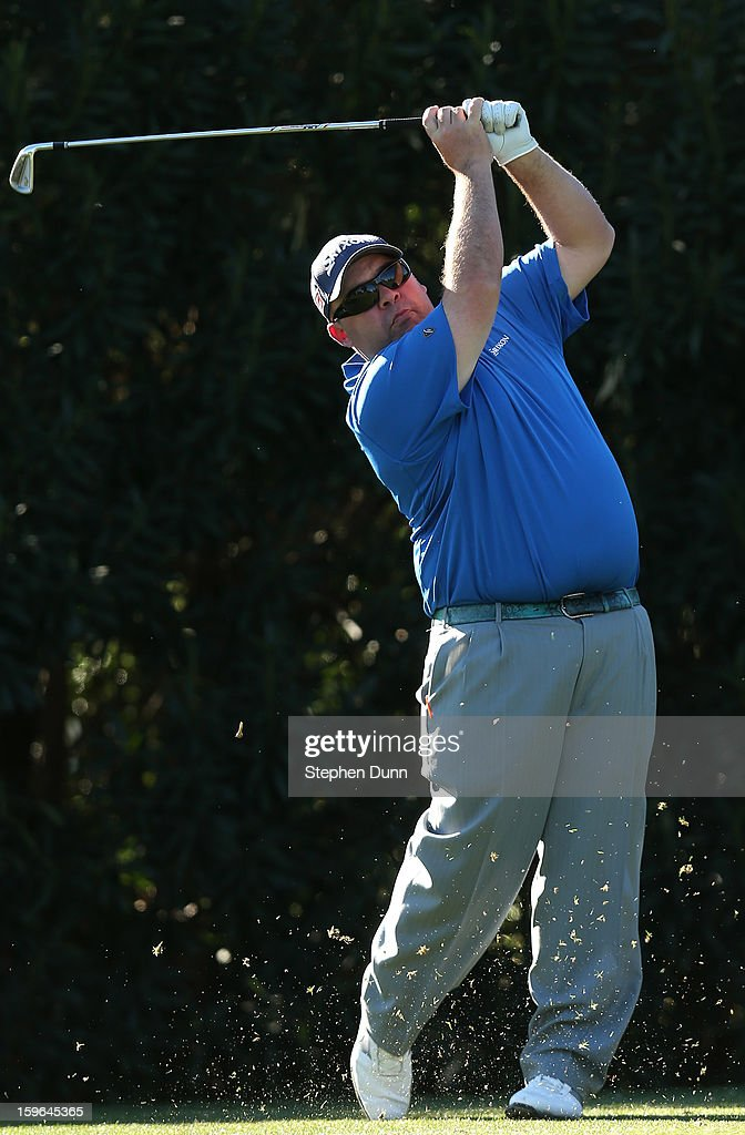 Kevin Stadler hits his tee shot on the 15th hole during the first round of the Humana Challenge in partnership with the Clinton Foundation at La Quinta Country Club on January 17, 2013 in La Quinta, California.
