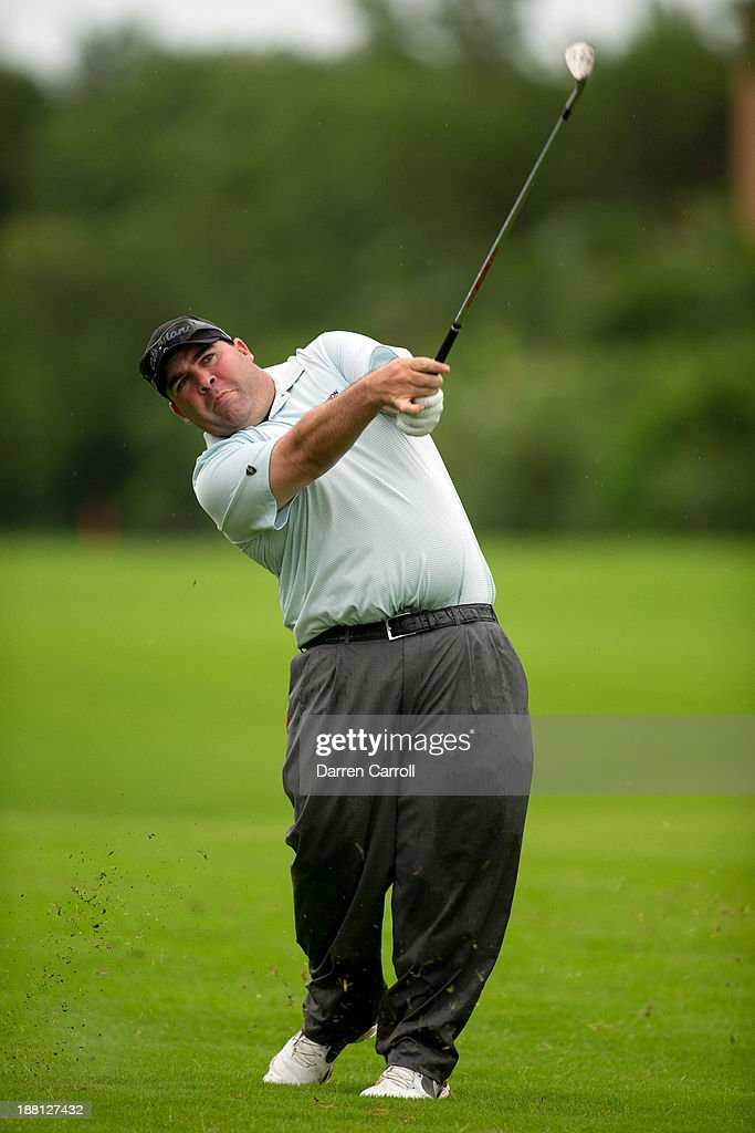 <a gi-track='captionPersonalityLinkClicked' href=/galleries/search?phrase=Kevin+Stadler&family=editorial&specificpeople=565814 ng-click='$event.stopPropagation()'>Kevin Stadler</a> of the United States plays an approach shot at the 17th hole during the second round of the 2013 OHL Classic at Mayakoba, played at El Camaleon Golf Club on November 15, 2013 in Playa Del Carmen, Mexico.