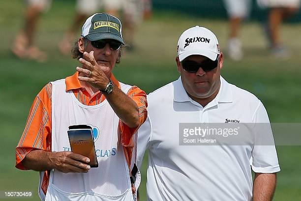 Kevin Stadler waits with his caddie on the 18th fairway during the third round of The Barclays at the Black Course at Bethpage State Park August 25...