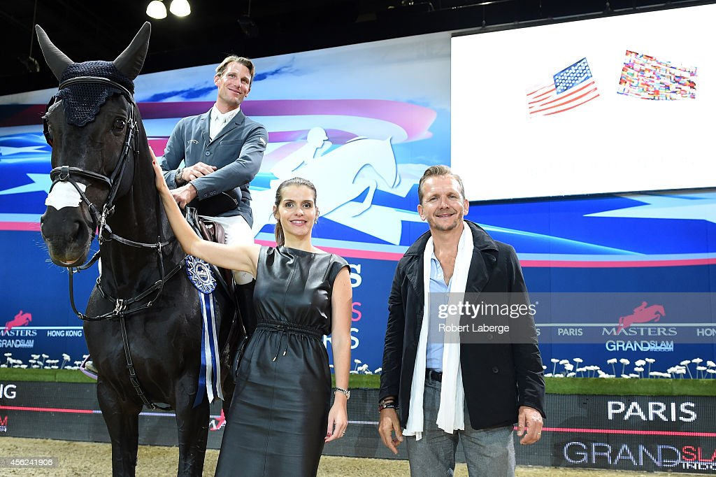 <a gi-track='captionPersonalityLinkClicked' href=/galleries/search?phrase=Kevin+Staut&family=editorial&specificpeople=4386325 ng-click='$event.stopPropagation()'>Kevin Staut</a> atop Oh d'Eole celebrates his fourth place finish in the Battle Of The Nations class at Longines Los Angeles Masters at Los Angeles Convention Center on September 27, 2014 in Los Angeles, California.