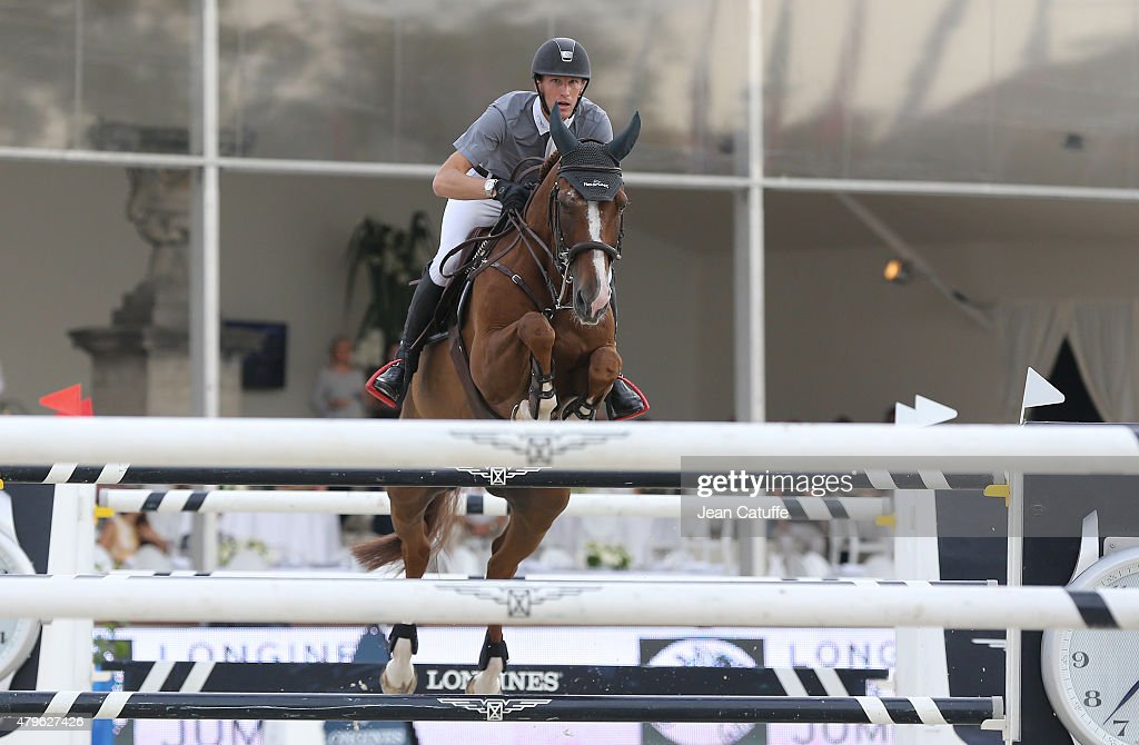 <a gi-track='captionPersonalityLinkClicked' href=/galleries/search?phrase=Kevin+Staut&family=editorial&specificpeople=4386325 ng-click='$event.stopPropagation()'>Kevin Staut</a> of France competes at the Paris Eiffel Jumping 2015 held at the Champs de Mars on July 5, 2015 in Paris, France.
