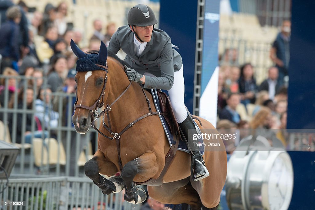 <a gi-track='captionPersonalityLinkClicked' href=/galleries/search?phrase=Kevin+Staut&family=editorial&specificpeople=4386325 ng-click='$event.stopPropagation()'>Kevin Staut</a> of France competes at the Paris Eiffel Jumping 2016 held at Parc de Bagatelle on July 1, 2016 in Paris, France.