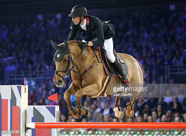 Kevin Staut of France competes in the Longines Speed Challenge show jumping event on day two of the Longines Paris Masters 2015 held at the ParisNord...
