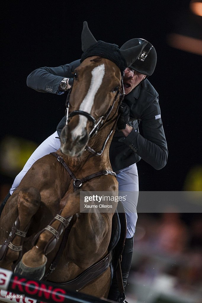 Kevin Staut of France rides Estoy Aqui de Muze HDC at the Longines Grand Prix during the Longines Hong Kong Masters International Show Jumping at Asia World Expo on March 2, 2013 in Hong Kong, Hong Kong.