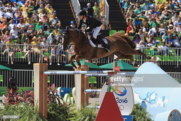 Kevin Staut of France rides Reveur De Hurtebise during the Team Jumping on Day 11 of the Rio 2016 Olympic Games at the Olympic Equestrian Centre on...