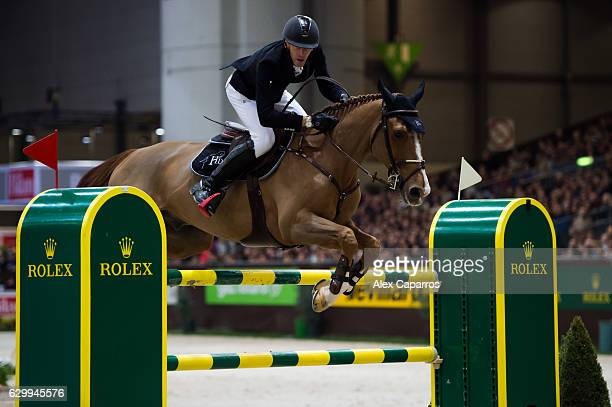 Kevin Staut of France rides Reveur de Hurtebise HDC during the Rolex Grand Slam of Show Jumping at Palexpo on December 11 2016 in Geneva Switzerland