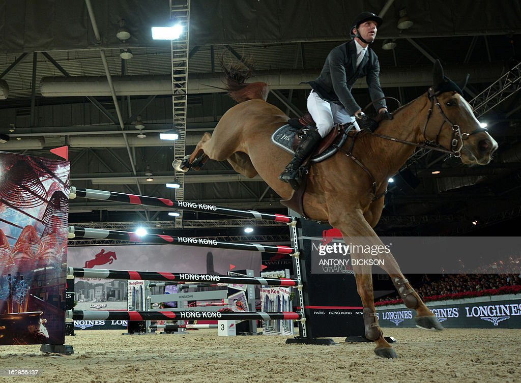 Kevin Staut of France riding Estoy Aqui de Muze competes in the international jumping competition Grand Prix equestrian event in Hong Kong on March 2, 2013. AFP PHOTO / Antony DICKSON