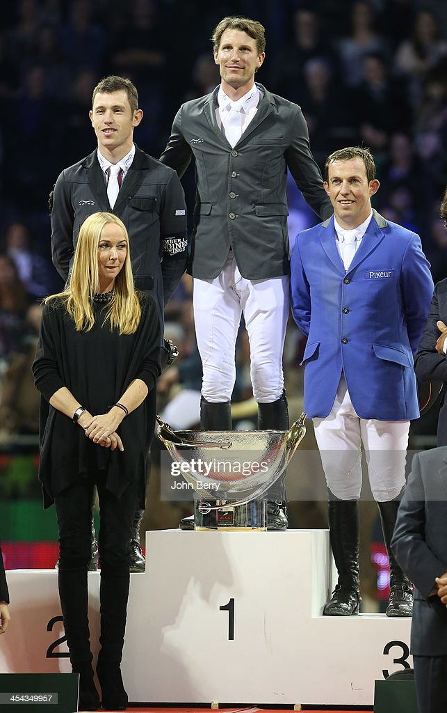Kevin Staut of France riding Silvana Hdc wins the Grand Prix Gucci in front of <a gi-track='captionPersonalityLinkClicked' href=/galleries/search?phrase=Scott+Brash&family=editorial&specificpeople=7104508 ng-click='$event.stopPropagation()'>Scott Brash</a> of Great Britain riding Ursula XII and Gerco Schroder of Netherlands (blue jacket) riding London at the Parc des Expositions Paris Nord Villepinte on December 8, 2013 in Villepinte near Paris, France.