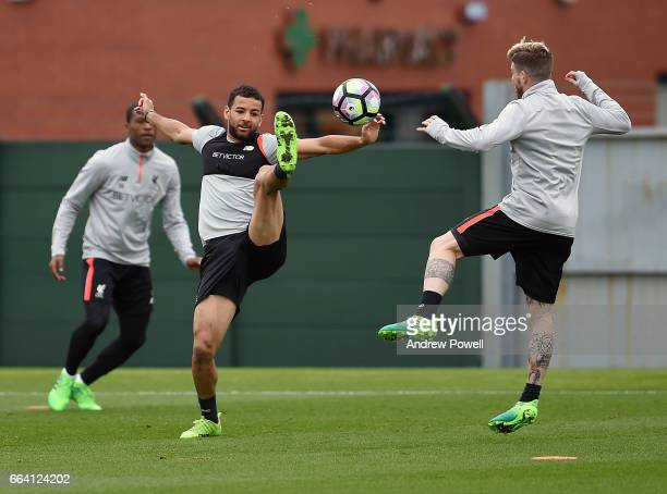 Kevin Stewart and Alberto Moreno of Liverpool during a training session at Melwood Training Ground on April 3 2017 in Liverpool England