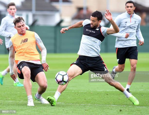 Kevin Stewart and Connor Randall of Liverpool during a training session at Melwood Training Ground on April 6 2017 in Liverpool England