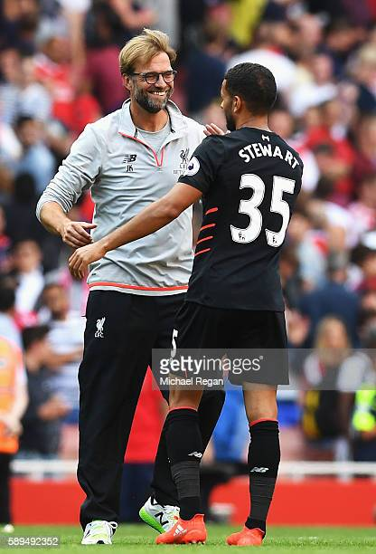 Kevin Stewart of Liverpool and Jurgen Klopp Manager of Liverpool celebrate victory during the Premier League match between Arsenal and Liverpool at...