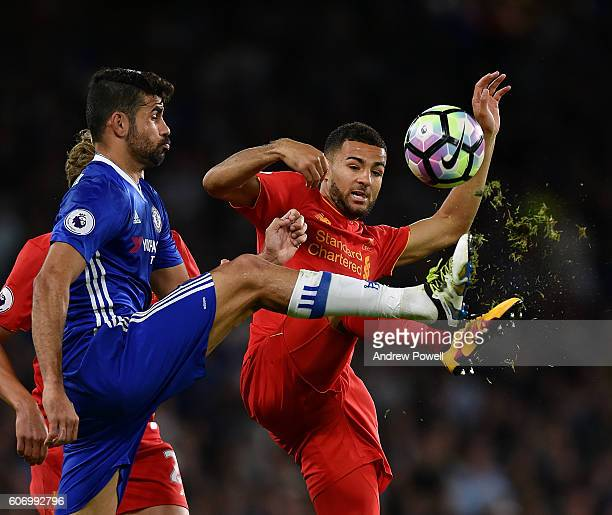Kevin Stewart of Liverpool competes with Diego Costa of Chelsea during the Premier League match between Chelsea and Liverpool at Stamford Bridge on...