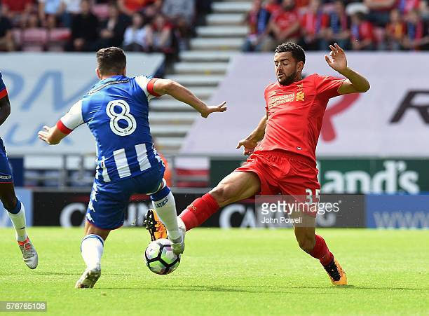 Kevin Stewart of Liverpool competes with Sam Morsy of Wigan Athletic during the PreSeason Friendly match between Wigan Athletic and Liverpool at JJB...
