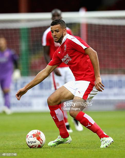 Kevin Stewart of Swindon Town runs with the ball during the pre season friendly match between Swindon Town and Aston Villa at the County Ground on...