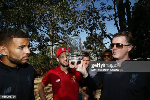 Kevin Stewart Steve McManaman and Adam Lallana look at spiders during a Liverpool FC player visit to Taronga Zoo on May 25 2017 in Sydney Australia