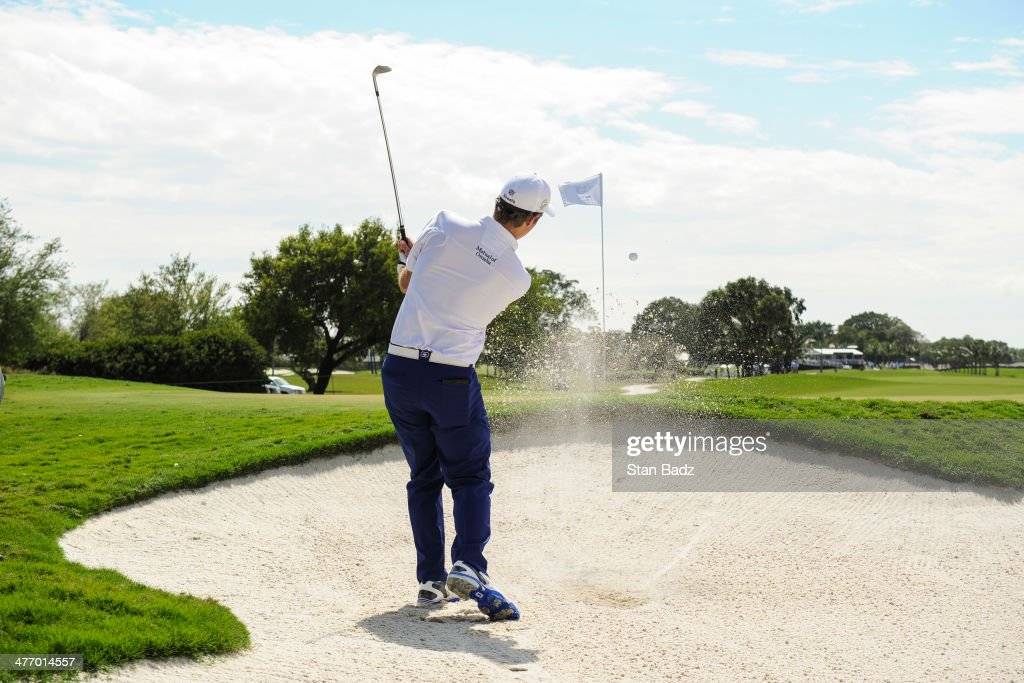 Kevin Streelman hits out of a bunker on the second hole during the first round of the World Golf Championships-Cadillac Championship at Blue Monster, Trump National Doral, on March 6, 2014 in Doral, Florida.