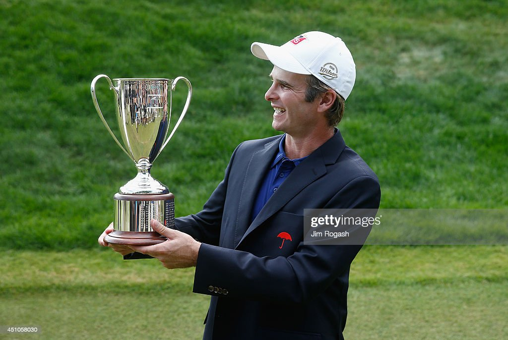 <a gi-track='captionPersonalityLinkClicked' href=/galleries/search?phrase=Kevin+Streelman&family=editorial&specificpeople=4687006 ng-click='$event.stopPropagation()'>Kevin Streelman</a> of the United States holds the trophy after winning the Travelers Championship golf tournament at the TPC River Highlands on June 22, 2014 in Cromwell, Connecticut.