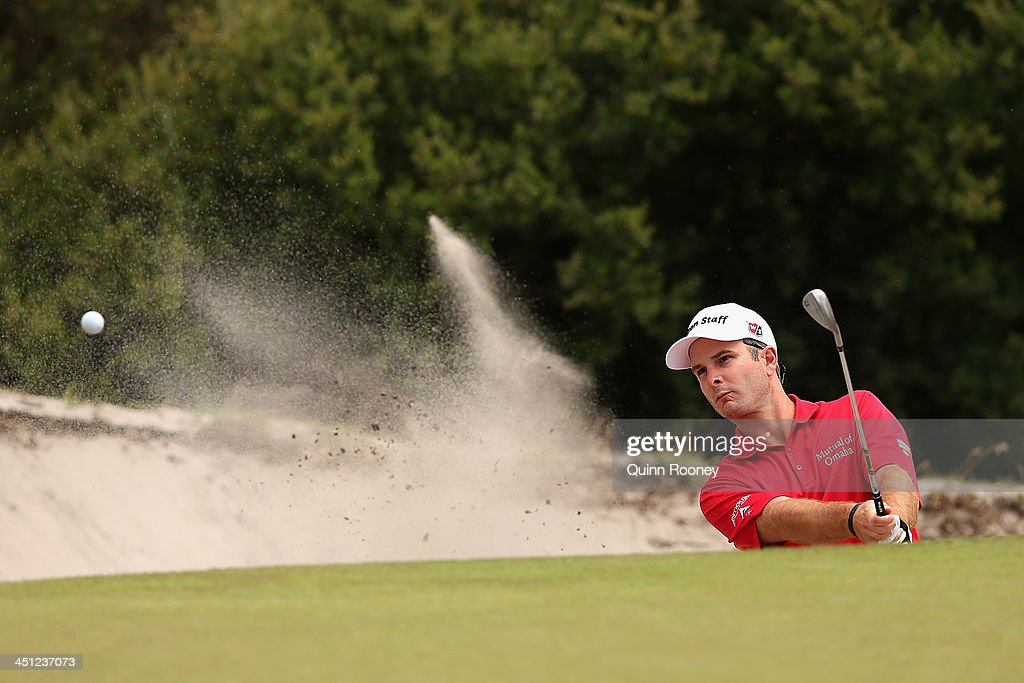<a gi-track='captionPersonalityLinkClicked' href=/galleries/search?phrase=Kevin+Streelman&family=editorial&specificpeople=4687006 ng-click='$event.stopPropagation()'>Kevin Streelman</a> of the USA plays out of the bunker during day two of the World Cup of Golf at Royal Melbourne Golf Course on November 22, 2013 in Melbourne, Australia.