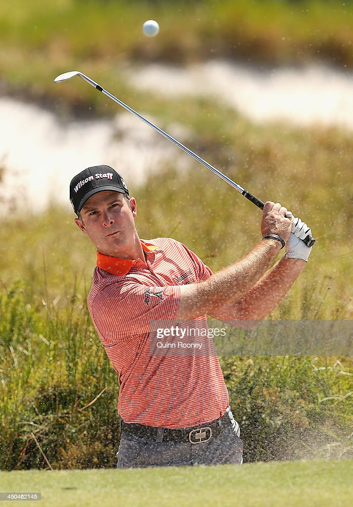 <a gi-track='captionPersonalityLinkClicked' href=/galleries/search?phrase=Kevin+Streelman&family=editorial&specificpeople=4687006 ng-click='$event.stopPropagation()'>Kevin Streelman</a> of the USA plays out of the bunker during practice ahead of the World Cup Of Golf at Royal Melbourne Golf Course on November 19, 2013 in Melbourne, Australia.