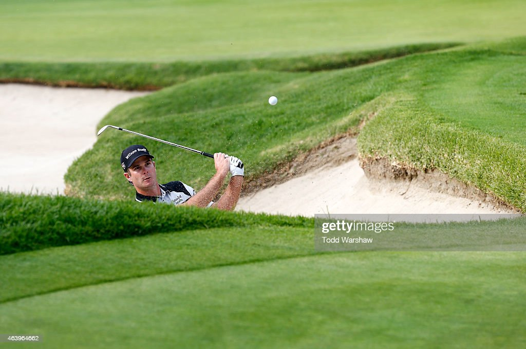 Kevin Streelman takes his shot out of the bunker on the 17th hole during round two of the Northern Trust Open at Riviera Country Club on February 20...