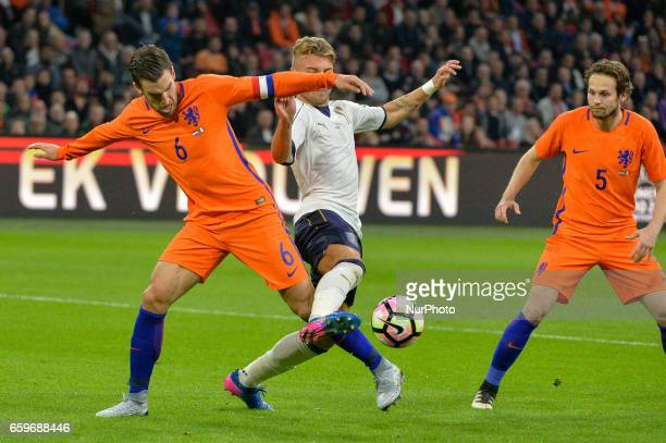 Kevin Strootman from the Netherlands Ciro Immobile from Italy and Daley Blind from the Netherlands during the friendly match between Netherlands and...