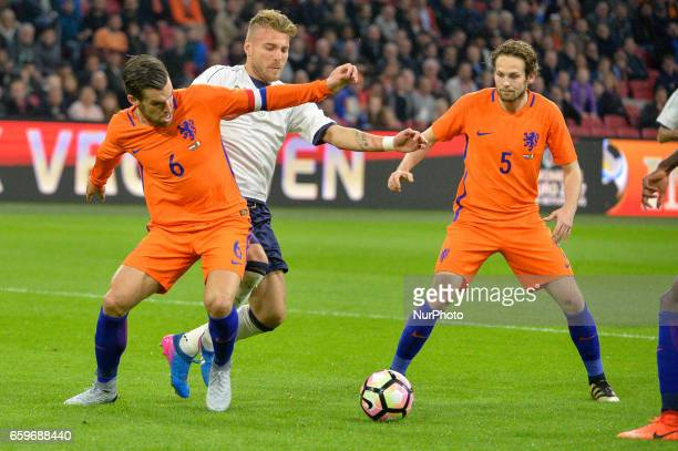 Kevin Strootman from the Netherlands vies Ciro Immobile from Italy and Daley Blind from the Netherlands during the friendly match between Netherlands...