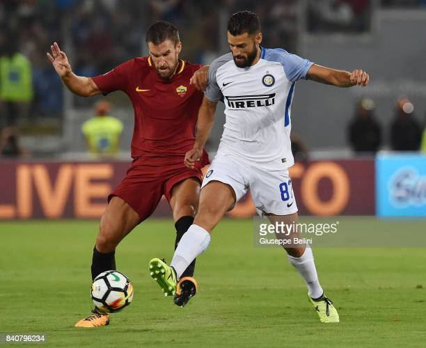 Kevin Strootman of AS Roma amd Antonio Candreva of FC Internazionale in action during the Serie A match between AS Roma and FC Internazionale at...