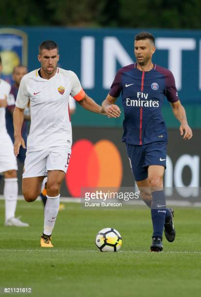 Kevin Strootman of AS Roma and Thiago Motta of Paris SaintGermain go after the ball during the first half at Comerica Park on July 19 2017 in Detroit...