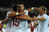 Kevin Strootman of AS Roma celebrates with his teammates after scoring the opening goal during the Serie A match between Torino FC and AS Roma at...