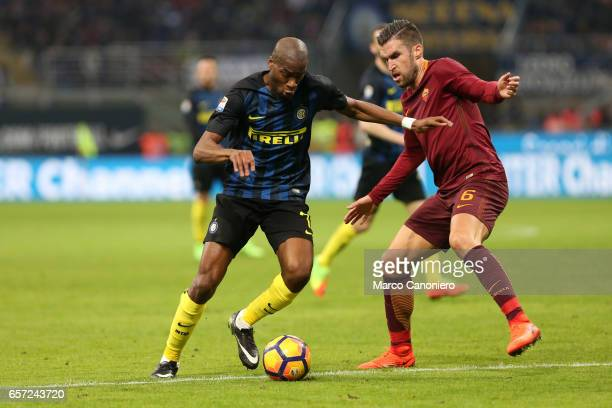 Kevin Strootman of AS Roma challenges for the ball with Geoffrey Kondogbia of FC Internazionale during the Serie A match between FC Internazionale...