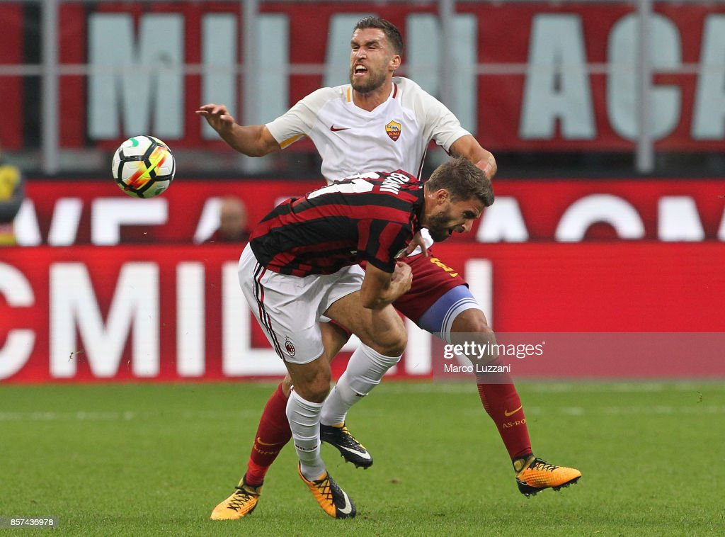 Kevin Strootman (back) of AS Roma clashes with Fabio Borini of AC Milan during the Serie A match between AC Milan and AS Roma at Stadio Giuseppe Meazza on October 1, 2017 in Milan, Italy.