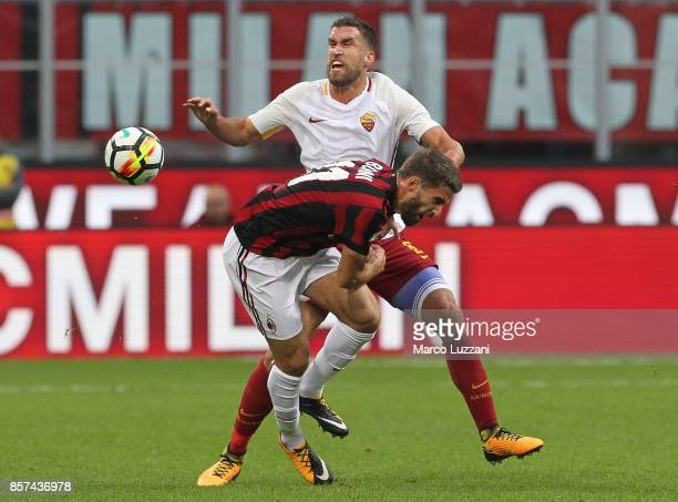 Kevin Strootman of AS Roma clashes with Fabio Borini of AC Milan during the Serie A match between AC Milan and AS Roma at Stadio Giuseppe Meazza on...