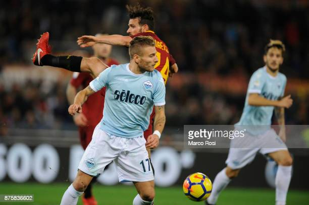 Kevin Strootman of AS Roma compete for the ball with Ciro Immobile of SS Lazio during the Serie A match between AS Roma and SS Lazio at Stadio...