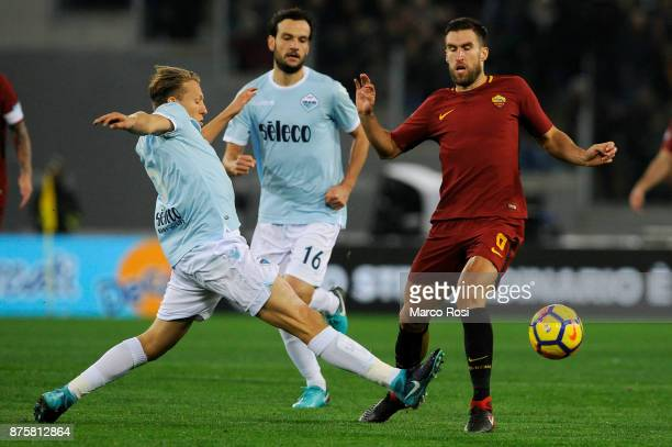 Kevin Strootman of AS Roma compete for the ball with Lucas Leiva of SS Lazio during the Serie A match between AS Roma and SS Lazio at Stadio Olimpico...