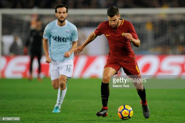 Kevin Strootman of AS Roma compete for the ball with Marco Parolo of SS Lazio during the Serie A match between AS Roma and SS Lazio at Stadio...