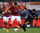 Kevin Strootman of AS Roma competes for the ball with Guarin of FC Internazionale Milano during the Serie A match between AS Roma and FC...