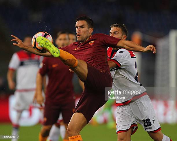 Kevin Strootman of AS Roma competes for the ball with Marcus Rohden of FC Crotone during the Serie A match between AS Roma and FC Crotone at Stadio...
