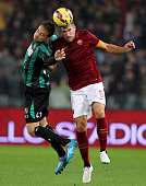 Kevin Strootman of AS Roma competes for the ball with Matteo Brighi of US Sassuolo Calcio during the Serie A match between AS Roma and US Sassuolo...