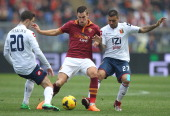Kevin Strootman of AS Roma competes for the ball with Sime Vrsaljko and Francelino Matuzalem of Genoa CFC during the Serie A match between AS Roma...