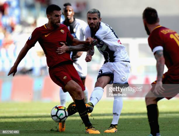 Kevin Strootman of AS Roma competes for the ball with Valon Behrami of Udinese Calcio during the Serie A match between AS Roma and Udinese Calcio at...