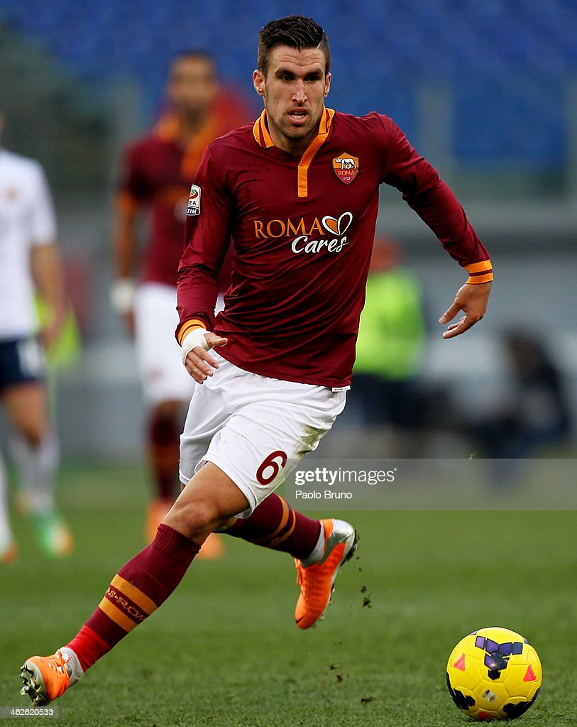 <a gi-track='captionPersonalityLinkClicked' href=/galleries/search?phrase=Kevin+Strootman&family=editorial&specificpeople=5566501 ng-click='$event.stopPropagation()'>Kevin Strootman</a> of AS Roma in action during the Serie A match between AS Roma and Genoa CFC at Stadio Olimpico on January 12, 2014 in Rome, Italy.
