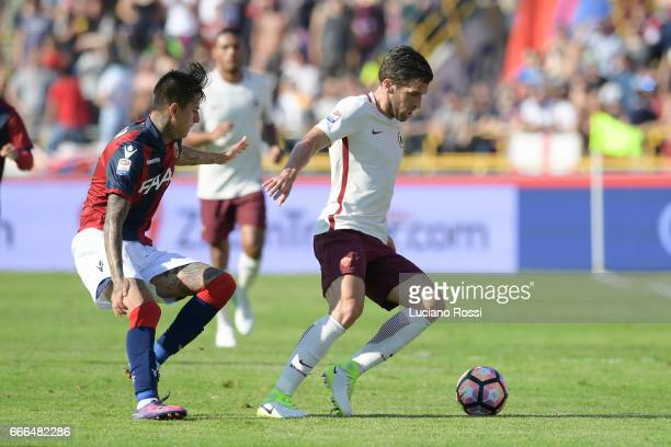 Kevin Strootman of AS Roma is challenged by Erick Pulgar of Bologna FC during the Serie A match between Bologna FC and AS Roma at Stadio Renato...