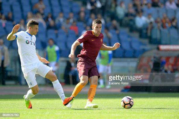 Kevin Strootman of AS Roma is challenged by Remo Freuler of Atalanta BC during the Serie A match between AS Roma and Atalanta BC at Stadio Olimpico...