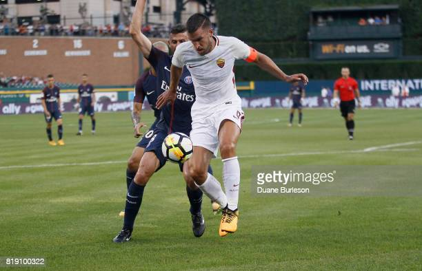 Kevin Strootman of AS Roma keeps the ball away from Thiago Motta of Paris SaintGermain during the first half at Comerica Park on July 19 2017 in...