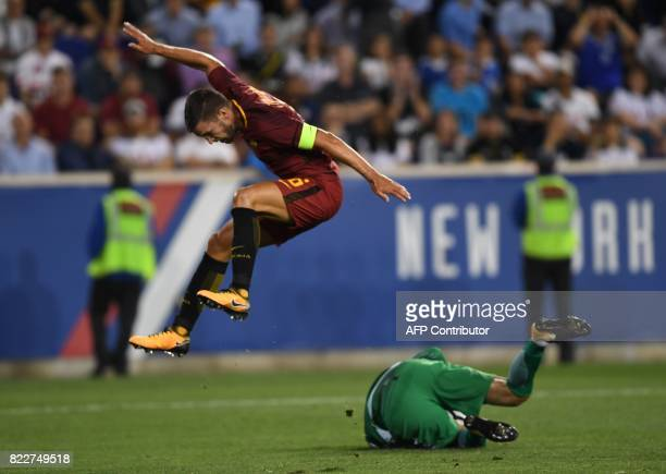 Kevin Strootman of AS Roma leaps above Tottenham Hotspur goalkeeper Hugo Lloris during their International Champions Cup football match against AS...
