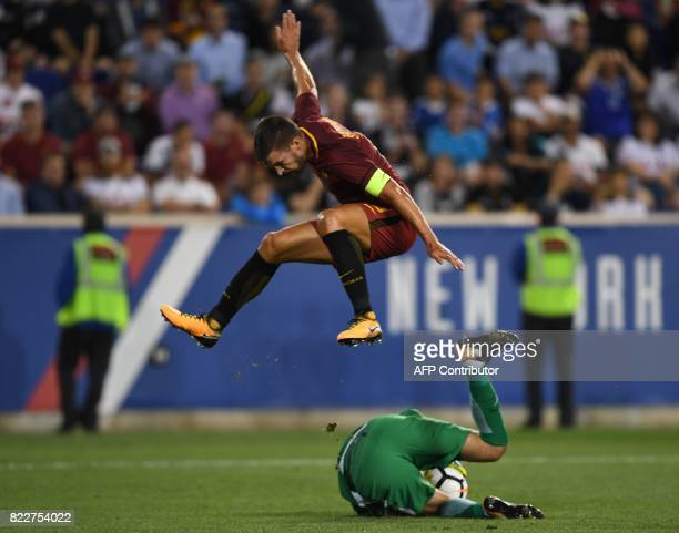 Kevin Strootman of AS Roma leaps above Tottenham Hotspur goalkeeper Hugo Lloris during their International Champions Cup football match between AS...