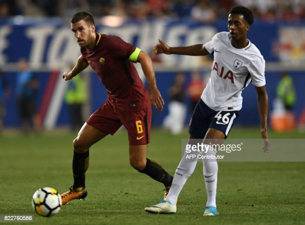 Kevin Strootman of AS Roma tries to control the ball before Tashan OakleyBoothe of Tottenham Hotspur during the International Champions Cup football...